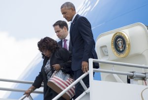 President Barack Obama disembarks from Air Force One alongside Sen. Marco Rubio and Rep. Corrine Brown as they arrive at Orlando International Airport in Florida on June 16, 2016. (Credit: Saul Loeb/AFP/Getty Images)