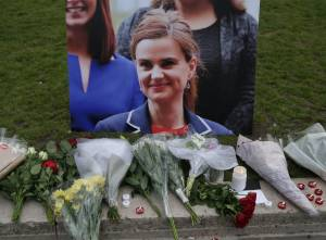 Floral tributes and candles are placed by a picture of slain Labour MP Jo Cox at a vigil in Parliament square in London on June 16, 2016. (Credit: DANIEL LEAL-OLIVAS/AFP/Getty Images)