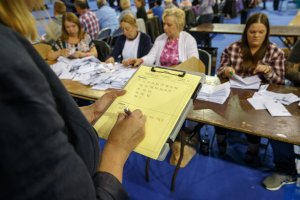 Staff count ballot papers at the Glasgow count centre at the Emirates Arena, Glasgow, Scotland, on June 23, 2016, after polls closed in the referendum on whether the UK will remain or stay in the European Union (EU). Millions of Britons began voting Thursday in a bitterly-fought, knife-edge referendum that could tear up the island nation's EU membership and spark the greatest emergency of the bloc's 60-year history. (Credit: ROBERT PERRY/AFP/Getty Images)