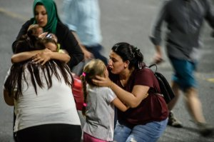 Children and their relatives embrace as they leave Ataturk airport on June 28, 2016 in Istanbul after two explosions followed by gunfire hit Turkey's biggest airport, killing at least 28 people and injuring 20. (Credit: Ozan Kose/AFP/Getty Images)