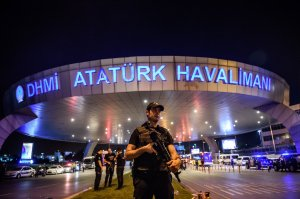 A Turkish riot police officer patrols Ataturk Airport's main entrance in Istanbul on June 28, 2016, after two explosions followed by gunfire hit Turkey's largest airport, killing at least 41 people and injuring 239. (Credit: Ozan Kose/AFP/Getty Images)