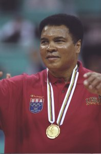 Muhammad Ali receives a replacement gold medal for one he lost many years ago during a halftime ceremony of the Yugoslavia v USA basketball game at the Georgia Dome at the 1996 Centennial Olympic Games in Atlanta, Georgia. (Credit: Getty Images)