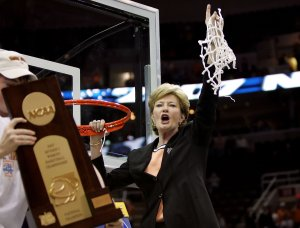 Head coach Pat Summitt of the Tennessee Lady Volunteers celebrates by cutting down the net after Tennessee's 59-46 win against the Rutgers Scarlet Knights to win the 2007 NCAA women's basketball championship game on April 3, 2007, in Cleveland, Ohio. (Credit: Jim McIsaac/Getty Images)