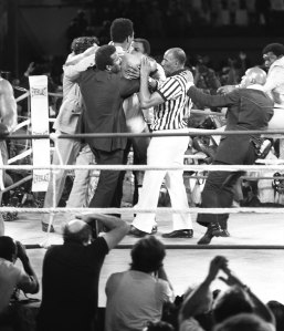 Muhammad Ali's staff and the referee put their arms around Muhammad Ali (Cassius Clay) who just won the title of heavyweight boxing champion match (Rumble in the the Jungle) against his compatriot and titlehoder George Foreman on October 30, 1974 Kinshasa, Congo. (Photo by: AFP/Getty Images)