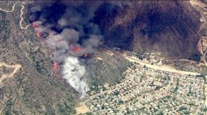 A brush fire burns along a hillside above Duarte on June 20, 2016. (Credit: KTLA)