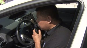 An ignition interlock device is demonstrated at a MADD media event in L.A. on June 24, 2016. (Credit: KTLA)