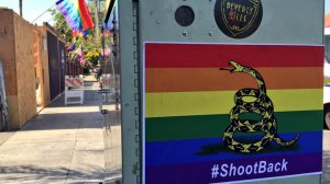 Stickers featuring a rainbow-colored version of the Gadsden flag were hanging near the Abbey Food & Bar, a well-known West Hollywood gay bar, on Thursday morning. (Credit: Hailey Branson-Potts/Los Angeles Times)