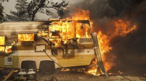 A trailer is engulfed by flames, on South Kelso Valley Road, in Weldon. (Marcus Yam / Los Angeles Times)