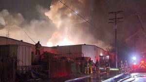 A magnesium fueled fire that burned through two commercial buildings in Maywood caused several explosions and left thousands without power Tuesday morning. (Credit: KTLA)
