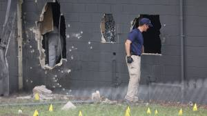 FBI agents investigate the damaged rear wall of the Pulse Nightclub where Omar Mateen allegedly killed at least 50 people on June 12, 2016 in Orlando. (Credit: Joe Raedle/Getty Images)