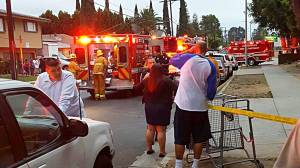 A witness provided this photo of firefighter-paramedics and police at the scene of a murder-suicide shooting in Panorama City on June 11, 2016.