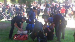 Several people were taken to hospitals on June 26, 2016 after violence broke out between a white supremacist group and counter-protesters. (Credit: CNN via KTXL)