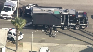 LAPD officers and a bomb squad surround an area in Culver City where a car matching the description and plates of the UCLA shooting suspect's was found on June 3, 2016. (Credit: Sky5)