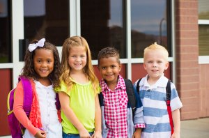 Kindergarten age kids are seen standing in front of their school in this file photo. (Credit: Thinkstock by Getty Images)
