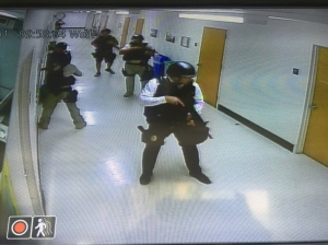 Officers are seen clearing the hallways following a fatal shooting at UCLA on June 1, 2016. (Credit: Karaface via Twitter)