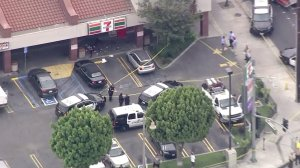 Authorities responded to a strip mall in the city of Bell after a shooting that possibly involved an officer on July 7, 2016. (Credit: KTLA)