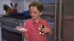 Seven-year-old San Gabriel resident Andrew Rindone shows off the two souvenirs he brought home from a family vacation to Costa Rica -- a stuffed toy and a botfly larvae that burrowed under his scalp. (Credit: KTLA)