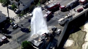 An RV sheared a fire hydrant and struck a fence on an overpass in Canoga Park on July 4, 2016. (Credit: KTLA)