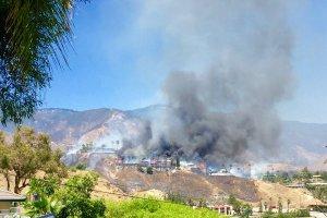 Homes burned in the area of San Bernardino's Skylark Drive on July 2, 2016. (Credit: Nathan Cooke/Twitter)