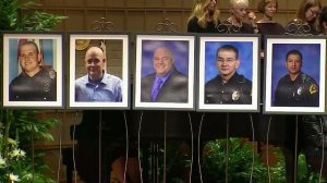 The five officer killed by a sniper in Dallas are shown in photos displayed at a memorial service for them on July 12, 2016. (Credit: CNN)
