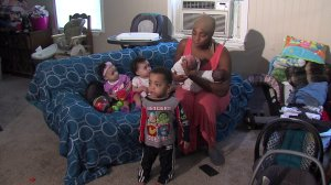 Danesha Couch sits with her five children from three sets of twins. One of the twins from the first set died as an infant. (Credit: WDAF)