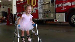 """Finley Smallwood appears in a still from a """"Dare to Dance"""" video with Los Angeles firefighters."""