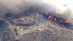 Smoke and flames rise from the Sand Fire on July 22, 2016. (Credit: KTLA)