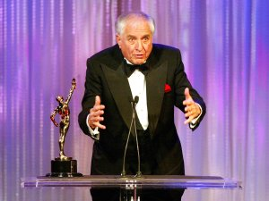 """Actor/director Garry Marshall receives the """"Filmmaker of the Year"""" award at the American Cinema Editors' 54th Annual ACE Eddie Awards at the Beverly Hilton Hotel on February 15, 2004 in Beverly Hills. (Credit: Kevin Winter/Getty Images)"""