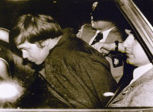 This 1981 file photo shows John Hinckley Jr. escorted by police in Washington, DC, following his arrest after shooting and seriously wounding then US president Ronald Reagan. (Credit: AFP/AFP/Getty Images)