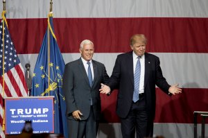 Republican presidential candidate Donald Trump greets Indiana Gov. Mike Pence at the Grand Park Events Center on July 12, 2016 in Westfield, Indiana. (Credit: Aaron P. Bernstein/Getty Images)