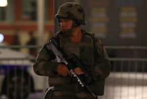 A soldier stands guard near the site of an attack in the French Riviera town of Nice, after a van that plowed into a crowd leaving a fireworks display on July 14, 2016. (Credit: VALERY HACHE/AFP/Getty Images)