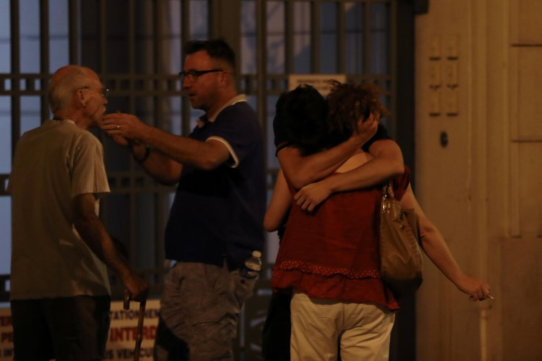 People react in the French Riviera town of Nice on July 15, 2016, after a vehicle drove into a crowd watching a fireworks display. (Credit: VALERY HACHE/AFP/Getty Images)