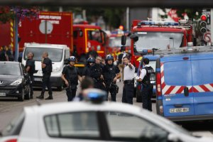 French police officers and fire engine arrive at the scene of a hostage-taking at a church in Saint-Etienne-du-Rouvray, northern France, on July 26, 2016 that left the priest dead. (Credit: CHARLY TRIBALLEAU/AFP/Getty Images)
