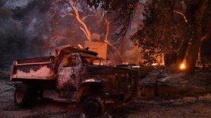 A truck and a house burn along Little Tujunga Canyon Road.(Credit: Wally Skalij / Los Angeles Times)