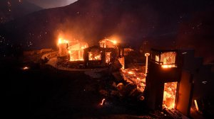 A house burns along Little Tujunga Canyon Road as the Sand Fire rages near Santa Clarita. (Credit: Wally Skalij / Los Angeles Times)