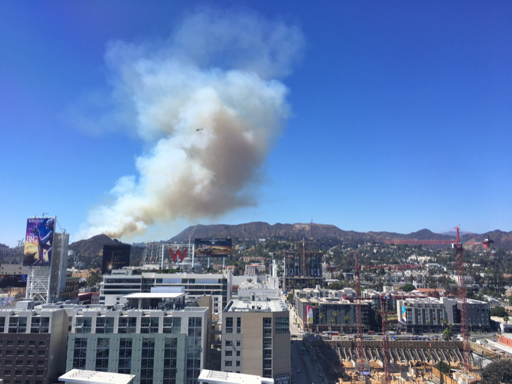 KTLA viewer Rick George submitted this photo of a fire towering over the Hollywood Hills on July 19, 2016.