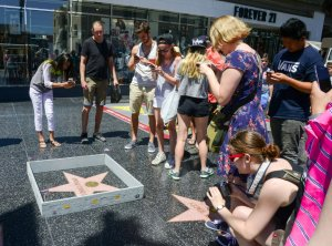 People take photos of a tiny wall around Donald Trump's star on the Hollywood Walk of Fame on July 19, 2016. (Credit: Plastic Jesus)
