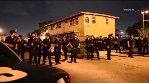 Police are seen in Watts after an officer was shot on July 25, 2016. (Credit: OnScene.TV)