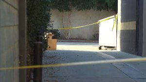 Crime scene tape marks the area where a woman's body was found in West Hollywood on July 6, 2016. (Credit: KTLA)