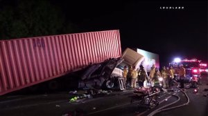 Three big rigs were involved in a crash on the 710 Freeway in Long Beach on Aug. 24, 2016. (Credit: Loudlabs)