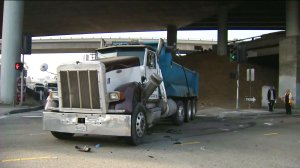 A dump truck is seen after a crash involving a Metro bus on Aug. 31, 2016. (Credit: KTLA)