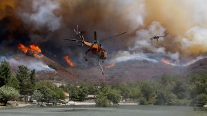 Firefighting helicopters battle the Blue Cut Fire as it burns out of control around the community of Lytle Creek. (Credit: Luis Sinco / Los Angeles Times)