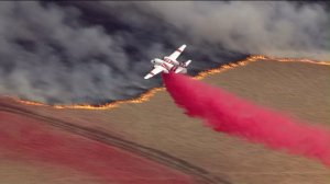 Crews battle the Bogart Fire from the air after the blaze broke out on Aug. 30, 2016. (Credit: KTLA)