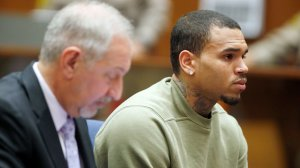 Singer Chris Brown and his attorney, Mark Geragos, attends a progress hearing at Los Angeles Superior Court on January 15, 2015 (Credit: Lucy Nicholson - Pool/Getty Images)