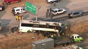 Authorities investigate a fatal bus crash in Merced County on Aug. 2, 2016. (Credit: KCRA via CNN)