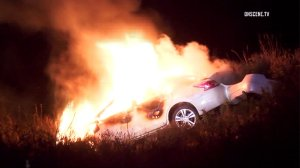 A car erupts in flames after the driver lost control in the Cajon Pass on Aug. 26, 2016. (Credit: OnScene.TV)