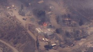 Structures burn in the Swarthout Canyon area during the Blue Cut Fire on Aug. 16, 2016. (Credit: KTLA)