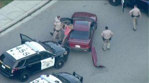 A driver was taken into custody when a pursuit came to an end in northern San Diego County on Aug 1, 2016. (Credit: KTLA}