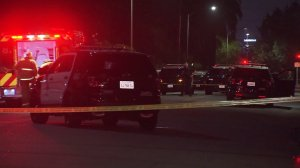 LAPD officials investigate the scene of an officer-involved shooting in East Hollywood on Aug. 16, 2016. (Credit: KTLA)