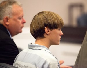 Dylann Roof, 21, listens to proceeding with assistant defense attorney William Maguire during a hearing at the Judicial Center July 16, 2015 in Charleston, South Carolina. (Credit: Randall Hill - Pool/Getty Images)